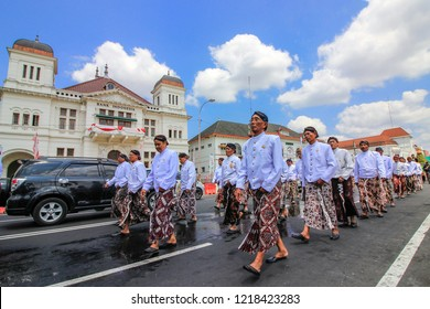 Yogyakarta, Indonesia - August 22th 2018 : Yogyakarta palace soldiers are walking follows the Gunungan Grebeg  Besar which is a cultural tradition in the Palace of Yogyakarta, Indonesia.