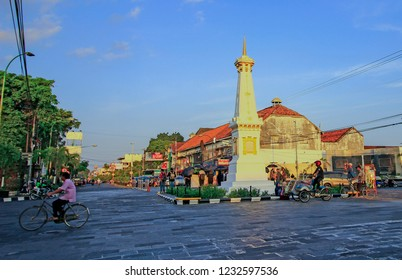 Yogyakarta, Indonesia - August 31, 2017: Th old man by bicycle in the morning at Yogyakarta monument (Indonesian: Tugu Yogyakarta).