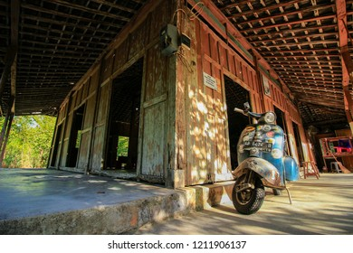 Yogyakarta, Indonesia - August 3rd 2018 : Joglo, tradisional house from Central Java, Indonesia / Scooter parking in Joglo House