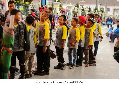 Yogyakarta, Indonesia - December 11, 2018: children queued to hear directions from officers