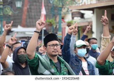 "Yogyakarta, Indonesia – December 18, 2020 : The mass action ''Jogja Bergerak untuk Keadilan dan HAM"" demands the release of Rizieq Shihab and the investigation of the shooting case of the FPI army"