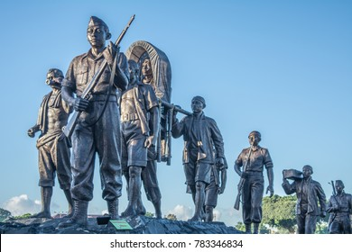 YOGYAKARTA, INDONESIA - December 23, 2017: The statue of General Sudirman together with soldiers (Patung Jenderal Sudirman) at Alun-Alun Utara