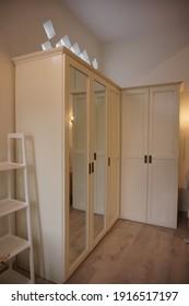 Yogyakarta, Indonesia - February 13 2021: Minimalist modern white wardrobe on a room decoration progress.
