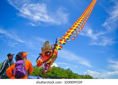 YOGYAKARTA, INDONESIA - February 17, 2018: Flight of the Dragon-shaped kite in Jogja Air Show 2018 at Depok airstrip