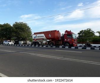 Yogyakarta, Indonesia, February 23, 2021. Truck coming up the road