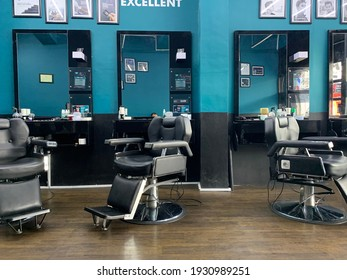 Yogyakarta, Indonesia-  February 24 2021: Empty chairs in stylish hairdressing salon interior