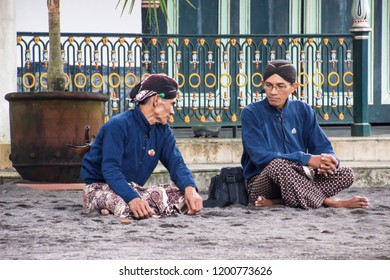 """Yogyakarta, Indonesia - February 28th 2017 : The """"Abdi dalem"""" or servant of the sultan was chatting in the palace of Yogyakarta / Kraton Yogyakarta is a beautiful place for vacation"""