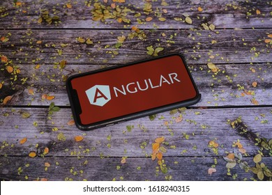 Yogyakarta, Indonesia - January 17, 2020; Angular Apple Store Application on a Iphone Screen on a Old Wooden Table with Leaves on it