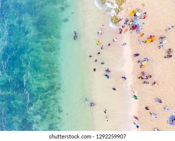YOGYAKARTA INDONESIA January 23 2019 : Holiday time, People bathing in the sun, swimming and playing games on the beach. Tourists on the sand beach, Aerial Beach, summer holiday, Sadranan Beach Jogja