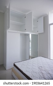 Yogyakarta, indonesia - January 27 2020: Minimalist modern white wardrobe with cabinet and mirror from several angle. White modern wardrobe from several angle.