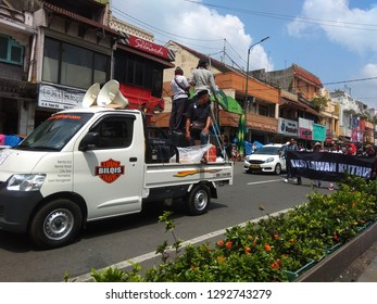 """Yogyakarta, Indonesia - January 9, 2019 : Hundreds of Yogyakarta residents held a """"Jogja Peaceful 9119"""" action by car and walked together from the Palace's North Square."""