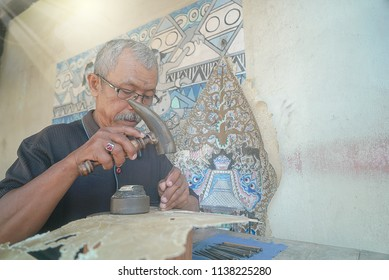YOGYAKARTA INDONESIA, JULY 20 2018 : Close Up Hand Making Wayang Kulit, traditional culture Indonesia