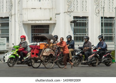 Yogyakarta, Indonesia - July 23 , 2019 : The becak is pedal powered tricycles with passenger seats, are one of the traditional modes of transportation that are still used today in Yogyakarta Indonesia