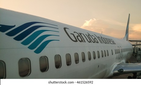 YOGYAKARTA, INDONESIA - JULY 30, 2016: A Garuda Indonesia Airplane at sunrise. Garuda Indonesia is the national airline of Indonesia.