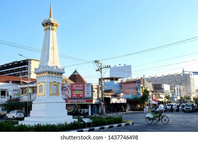 Yogyakarta / Indonesia - June 29 2019 : Becak, rickshaw, traditional vehicle in Indonesia, ride along Tugu Yogyakarta.