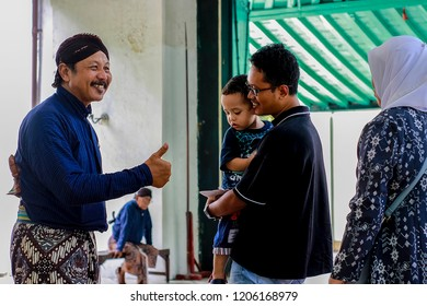 """Yogyakarta, Indonesia - March 20th 2018 : The """"Abdi dalem """" or servant of the Sultan are welcome tourists with a smile in the Kraton of Yogyakarta, Yogyakarta Indonesia / Yogyakarta is a friendly city"""
