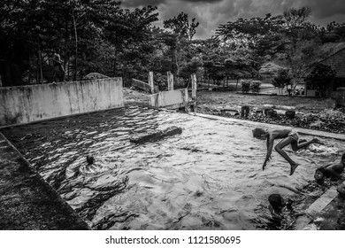 YOGYAKARTA, INDONESIA - March 3, 2018: black and white photos of young children who were playing and swimming in the pool of the former factory of eucalyptus oil
