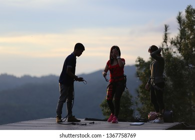 Yogyakarta, Indonesia - March 9, 2017 : Asian woman enjoying beautiful view of sunset at Kalibiru, Kulonprogo, Yogyakarta, indonesia