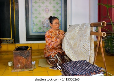 Yogyakarta, Indonesia - May 18th 2019 : The process of making batik on Kraton Yogyakarta. Batik is Indonesia's cultural heritage that have a value and a mix of high art