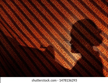 YOGYAKARTA, INDONESIA - MAY 22, 2019: Silhouette of an old Javanese woman paints an Indonesian traditional fabric called Batik in Yogyakarta on May 22, 2019.