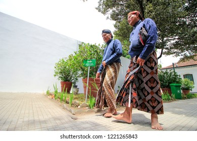 """Yogyakarta, Indonesia - November 4th 2018 : The """"Abdi dalem"""" or servant of the sultan was chatting while walking in the palace of Yogyakarta"""