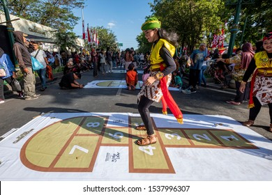 Yogyakarta, Indonesia - October 1 2019 : Dolanan anak or traditional games for children at the Selasa Wage (Wagen on Tuesday) in Malioboro. Wage is one of day name in javanese calendar
