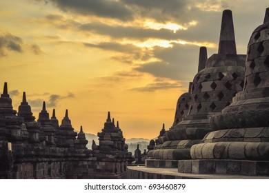 Yogyakarta, Indonesia, October 2, 2015: The UNESCO heritage temple of Borobudur in Java, Indonesia, at sunrise. General travel imagery for Indonesia.