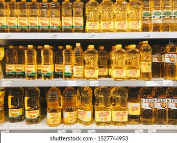 Yogyakarta, Indonesia - October, 2019: Variety brand of cooking oil in Indonesia on display rack at supermarket shelf.