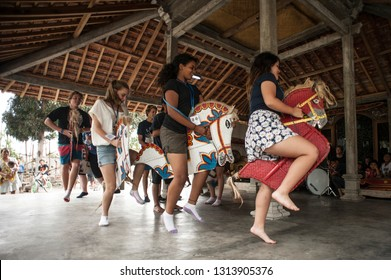 Yogyakarta, Indonesia, October 6, 2012: Students from Australia learn to play traditional Javanese, lumping horses (Jaranan)