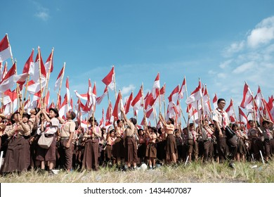 Yogyakarta, Indonesia, raising a thousand red and white flags to commemorate the day of Scouting (Pramuka)