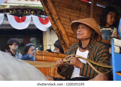 Yogyakarta, Indonesia - September 11th 2017: Coachman or commonly called Bajingan when driving a carriage in the street