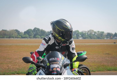 YOGYAKARTA, INDONESIA -SEPTEMBER 5 2018: A cool front view of a superbike rider. Photo at Adisutjtipto International Airport taxiway.