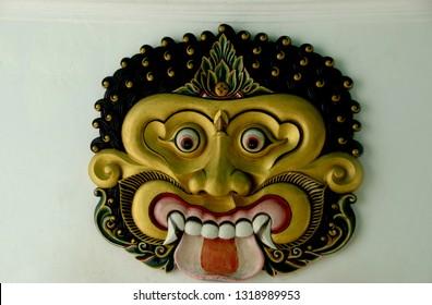 Yogyakarta, Java, Indonesia - July 16, 2012. Head Sculpture of Batara Kala, God of the Underworld and Symbol of Time. A Hindu-Buddhist Javanese-Balinese Deity