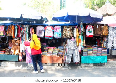 YOGYAKARTA JULY 2018 - Street vendors are selling their souvenir and t-shirt in a pedestrian ways nearby the Sultan Palace during July holiday season