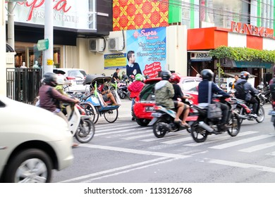 YOGYAKARTA JULY 2018 - Vehicles are moving on Jalan Solo primary commercial district in Yogyakarta during sunny day