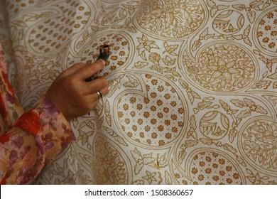 Yogyakarta June 16, 2019: Close-Up Hand Batik Painting on Fabric. Batik Batik in Indonesia jogja