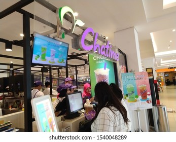 Yogyakarta - October 21, 2019: customers are waiting in line to order drinks at the Chatime shop. Popular milk tea franchise in Indonesia