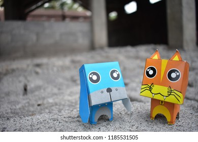 Yogyakarta, September 22, 2018 : Cat and dog paper toys. Cat and dog paper toys made by ganeshandra. This is Cat and dog paper toys. Shoot at outdoor area.