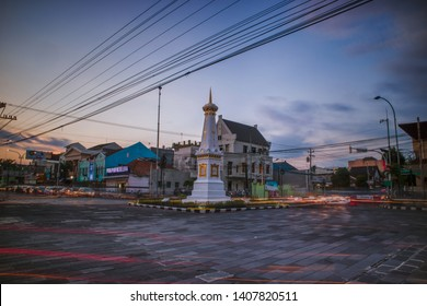 Yogyakarta / Tugu Pal Putih - Indonesia May 23, 2019: Beautiful sunset at landmark of Yogyakarta, Tugu Pal Putih. Tugu Jogja or Yogyakarta Monument in blue hours with vehicle traffic light trail