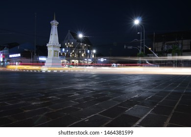Yogyakarta / Tugu Pal Putih - Indonesia May 23, 2019: Tugu Jogja or Yogyakarta Monument in blue hours with vehicle traffic light trail blue hours