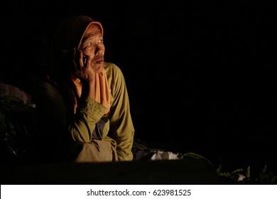 YOGYAKARTA,INDONESIA - 01 APRIL 2017 : A aged woman in hijab was thinking something while she was sitting in Yogyakarta old market, Kotagede.