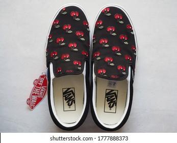YogyakartaIndonesia - July 17 2020: A pair of black Vans slip-on shoes with cherry fruit motive