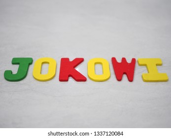 "Yogyakarta/Indonesia - March 13 2019: ""Jokowi"" word made from colorful wooden letter. ""Jokowi"" is the name of Indonesia president candidate for election that will be held on April 2019"