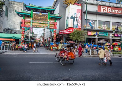 Yogyakarta,Indonesia-10.07.2018: Malioboro street with Colorful Tricycle and driver on the street of Malioboro, Indonesia