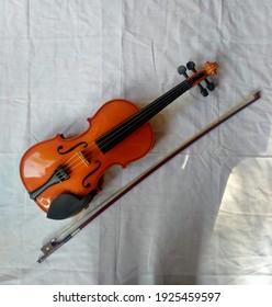 YOGYAKARTA,INDONESIA-February 27th,2021-Violin with white fabric background