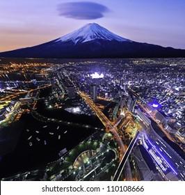 YOKOHAMA - AUG 4: Aerial view of harbor and Mt Fuji in Yokohama, Japan on Aug 4, 2012. With 3.6 million inhabitants Yokohama is a major commercial hub of the Greater Tokyo Area.