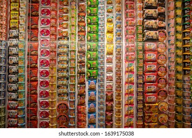Yokohama, Japan - 8th February: Front view off different instant noodles packaging at the Instant Noodles History Cube at Cupnoodles Museum.