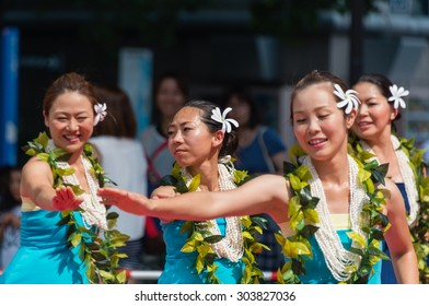 YOKOHAMA, JAPAN - AUGUST 1, 2015: Japanese women are performing a Hawaiian dance in the Yokohama Dance Parade which is held on August 1 through 2 in 2015 in Yokohama, Japan.