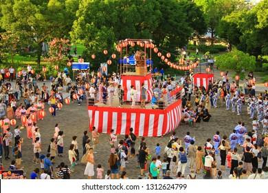YOKOHAMA, JAPAN - AUGUST 17, 2018: Bon Festival, a major Japanese summer festival, held at a park in Yokohama. People celebrate by performing traditional Bon dance and having a carnival.