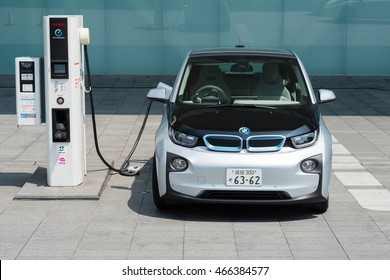 YOKOHAMA, JAPAN - AUGUST 4, 2016: An electric car, BMW i3, is being charged at the charging station in front of the entrance of Nissan Global Headquarters located in Yokohama, Japan.